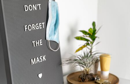 COVID-19 sign remembers to wear and at business stores. Message to remind the family to take the medical mask to go outside during the coronavirus pandemic