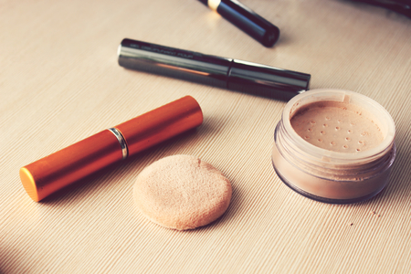 powder puff: Mirror, powder, puff, mascara, eyeliner and other cosmetics on the table Stock Photo