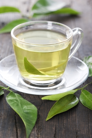 Cup of green tea on a wooden table Stock Photo - 9098105