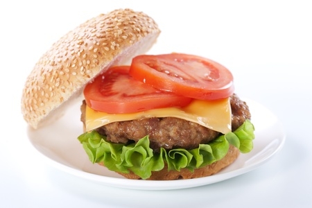 Cheeseburger with tomatoes and lettuce isolated on white Stock Photo