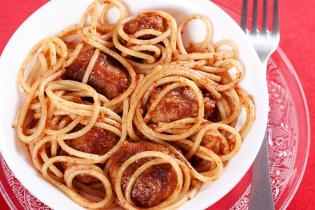 Pasta with meatballs and tomato sauce on red background  Stock Photo
