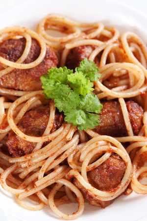 Pasta with meatballs and tomato sauce on white background  photo