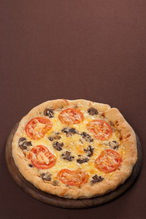 Fresh baked pizza with mushroom and tomatoes photo