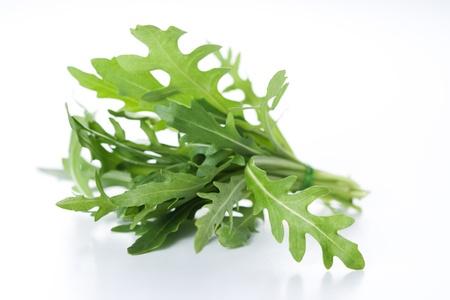ruccola: Ruccola salad fresh heap leaf isolated on white  Stock Photo