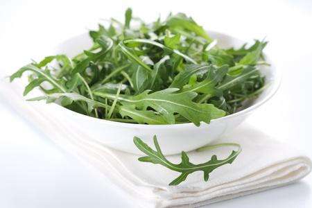 Green rucola fresh salad in white bowl  Stock Photo - 9231000