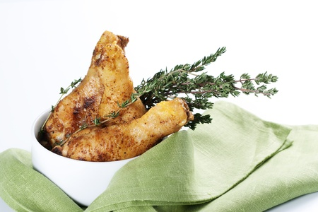 Roasted chicken legs with thyme in a bowl photo