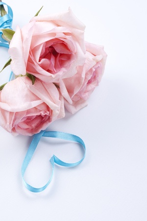 A bouquet of roses with ribbon in heart shape  photo