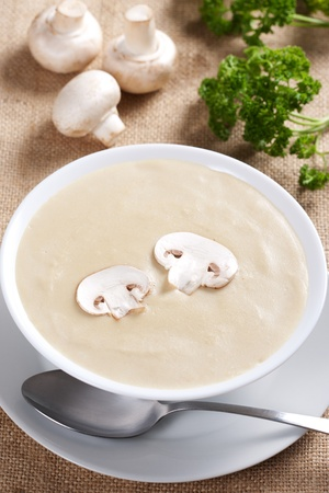 Bowl of mushroom soup with fresh mushrooms and parsley Stock Photo - 9255601