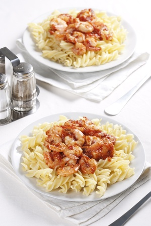 pepperbox: Two plates of pasta with tomato and prawns Stock Photo