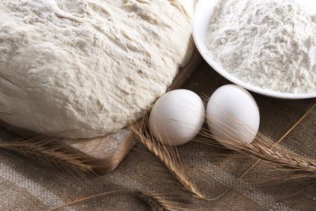 Baking fresh bread background, dough
