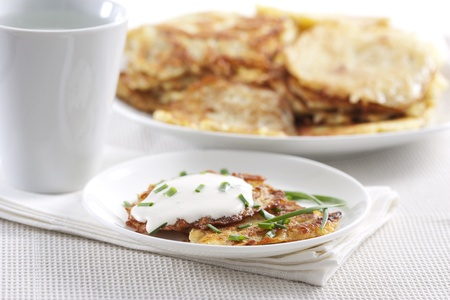 Potato pancakes on plate with sour cream Stock Photo - 9255095