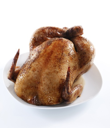 Tasty crispy roast chicken on white plate .  Stock Photo