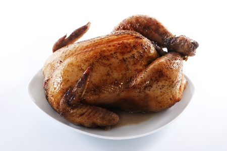 Tasty crispy roast chicken on white plate .  Stock Photo