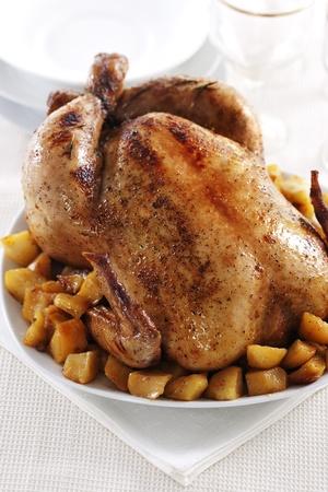 Tasty crispy roast chicken and potato on white plate.  Stock Photo
