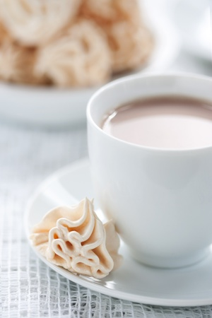 Meringues and cup of chocolate drink photo