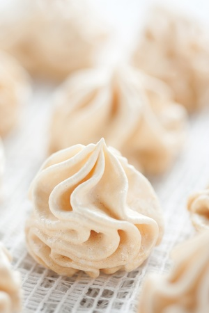 Meringues on white tablecloth Stock Photo