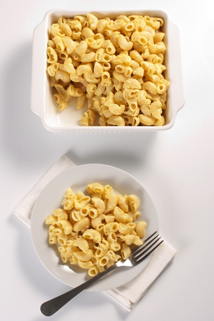 Macaroni and cheese in the casserole and plate photo