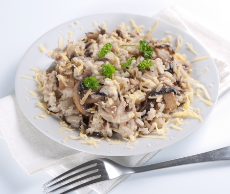 Mushroom risotto with parsley, italian cuisine. Stock Photo