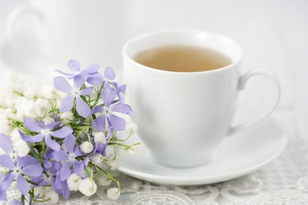 Cup of tea and spring flowers  Stock Photo