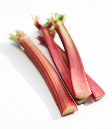 Fresh organic rhubarb isolated on white background  photo