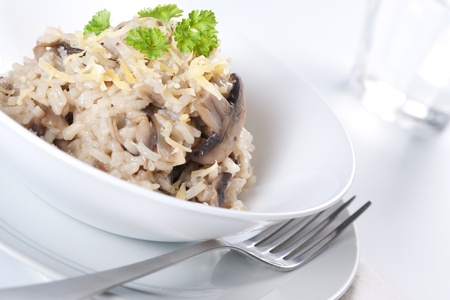 Mushroom risotto with parsley, italian cuisine. photo