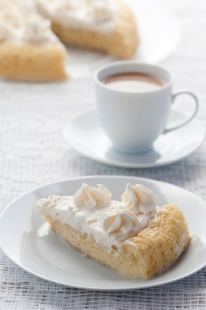 Tres leches cake served with a hot chocolate