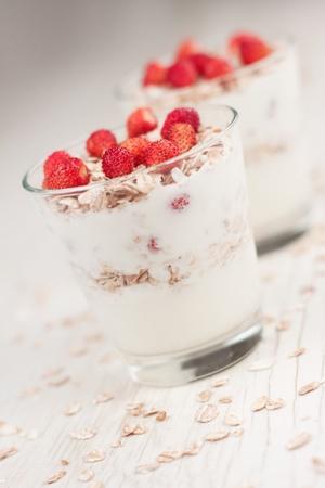 Natural yogurt with muesli and wild strawberries photo