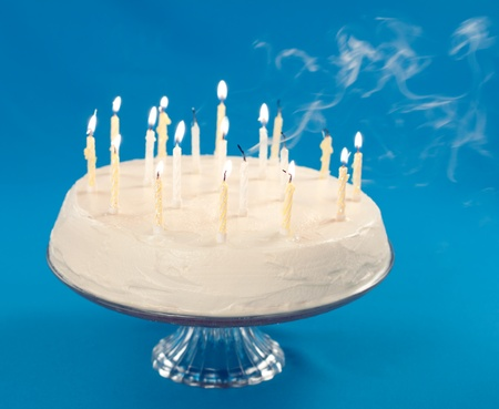Birthday cake with smoke coming from blown out candles  Stock Photo - 9898524