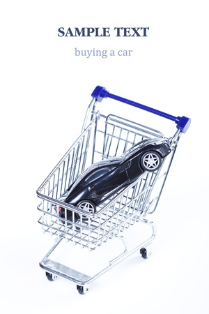 Buying a car, a black auto inside a shopping cart photo