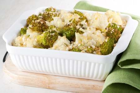 Broccoli and cauliflower gratin in white casserole  Stock Photo