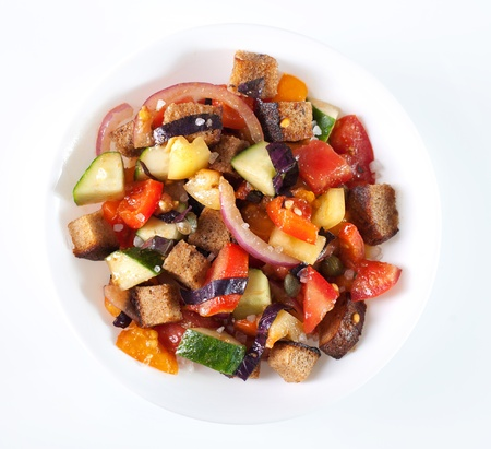 Italian panzanella bread salad in white bowl