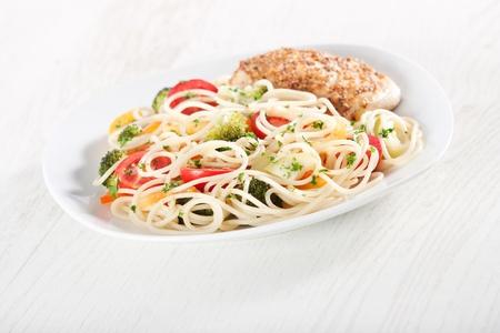 Pasta primavera and chicken breast in french mustard
