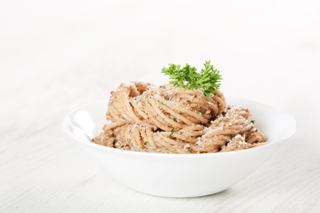 Tasty pasta with walnut cream sauce, cheese and parsley