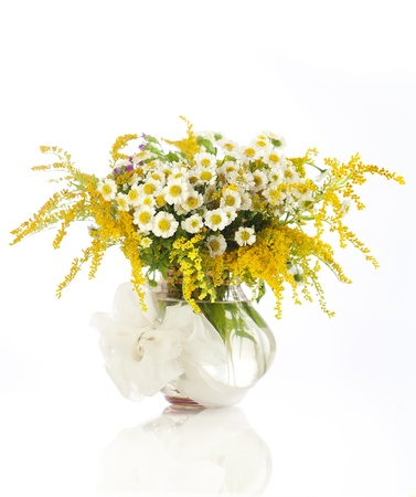 Beautiful bouquet of wildflowers in vase isolated on white photo