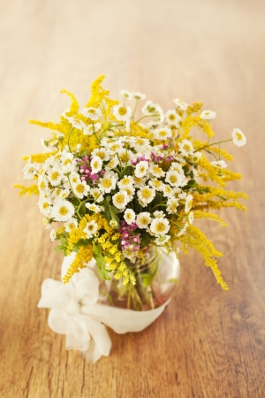 Beautiful bouquet of wildflowers in vase on wooden background Stock Photo - 14842399