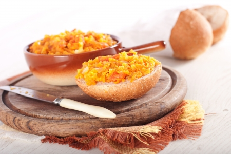 Roasted pumpkin and fresh bread on wooden backround photo