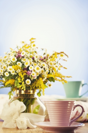 Two cups of tea and summer flowers Stock Photo - 14842392