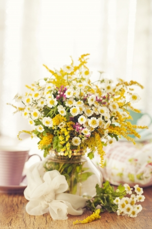 Two cups of tea and summer flowers photo