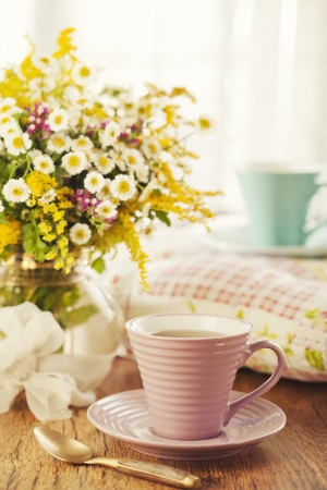 Two cups of tea and summer flowers