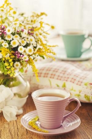 tea garden: Two cups of tea and summer flowers