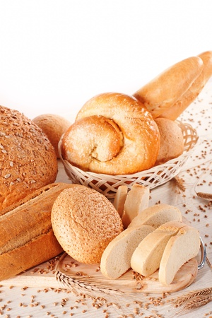 Assortment of baked bread on white background Stock Photo - 14842393