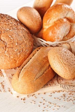 Assortment of baked bread on white background Stock Photo - 14842398