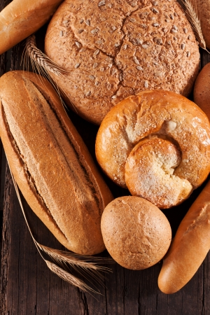 Assortment of baked bread on wooden table Stock Photo - 14842403