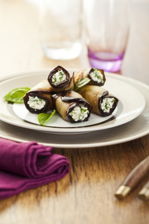 Tasty eggplant rolls stuffed with cottage cheese Stock Photo - 14953899