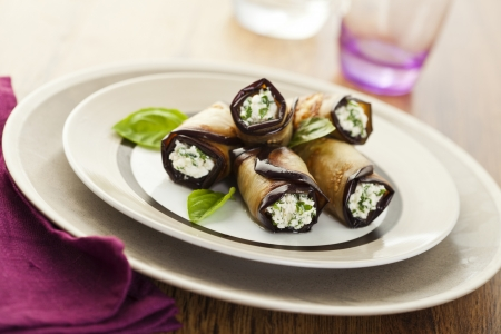 Tasty eggplant rolls stuffed with cottage cheese