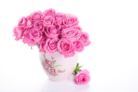floral arrangements: Pink roses in vase isolated on white background Stock Photo