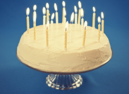 Birthday cake with candles on blue background Stock Photo - 17925514