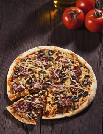Tasty pepperoni pizza on wooden table Stock Photo - 17925523