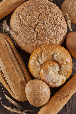 Assortment of baked bread on wooden table Stock Photo - 17925547