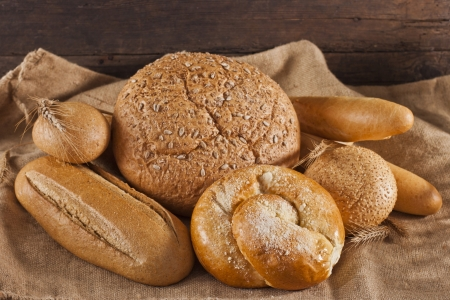 Assortment of baked bread on wooden table Stock Photo - 17925520